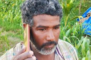 Indian farmer on mobile phone