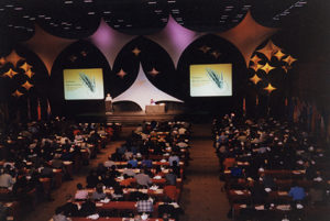 Birds-eye view of participants watching opening ceremony at PCF2