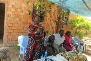 Women addressing group of farmers in Tanzania