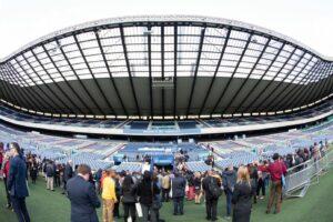 Delegates on Murrayfield Stadium field during reception